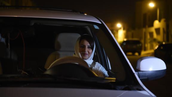 Saudi Samar Almogren prepares to drive her car through Riyadh city