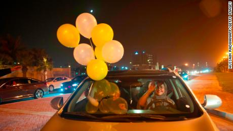 A Saudi woman and her friends celebrate her first time driving on a main street of Khobar City, Saudi Arabia on her way to Bahrain on June 24, 2018.