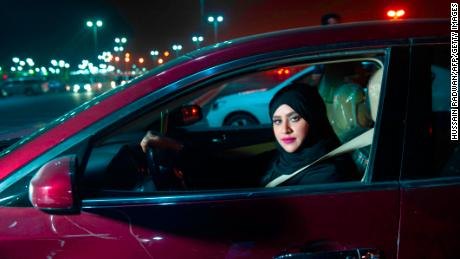 Saudi woman Sabika Habib drives her car through the streets of Khobar City, Saudi Arabia on her way to Bahrain on June 24, 2018.