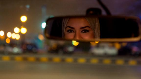 Walaa Abou Najem, 30, drives her car for the first time through the streets of Riyadh early Sunday.