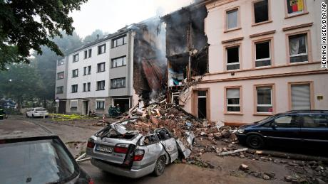 A car and a house are destroyed after an explosion in Wuppertal, Germany, June 24, 2018. German police say 25 people were injured, when an explosion destroyed a several-store building in the western city of Wuppertal. (Henning Kaiser/dpa via AP)