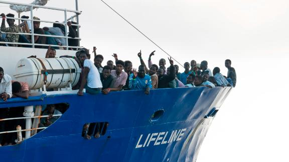 In this photo taken on Thursday, June 21, 2018, migrants wave from aboard ship operated by the German NGO Mission Lifeline. Italy's interior minister says Malta should allow a Dutch-flagged rescue ship carrying 224 migrants to make port there because the ship is now in Maltese waters. Salvini said the rescue was in Libyan waters, which Lifeline denies. (Hermine Poschmann/Mission Lifeline via AP)
