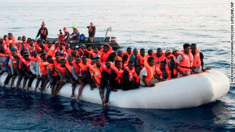 Migrants on a rubber boat are rescued by the Lifeline ship on Thursday.