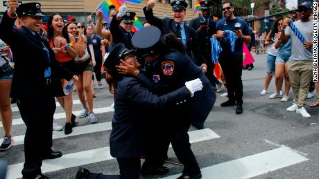 NEW YORK, NY - JUNE 24:  Members of the New York City Fire Department cheer as EMT Trudy Bermudez and paramedic Tayreen Bonilla get engaged at the annual Pride Parade on June 24, 2018 in New York City. The first gay pride parade in the U.S. was held in Central Park on June 28, 1970.  (Photo by Kena Betancur/Getty Images)