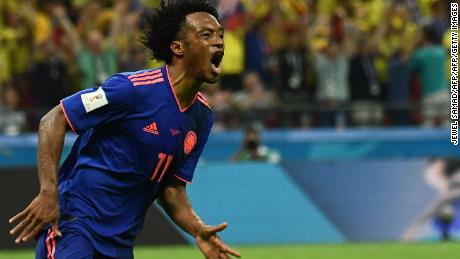 Colombia's forward Juan Cuadrado celebrates after scoring during the Russia 2018 World Cup Group H football match between Poland and Colombia at the Kazan Arena in Kazan on June 24, 2018. (Photo by Jewel SAMAD / AFP) / RESTRICTED TO EDITORIAL USE - NO MOBILE PUSH ALERTS/DOWNLOADS        (Photo credit should read JEWEL SAMAD/AFP/Getty Images)