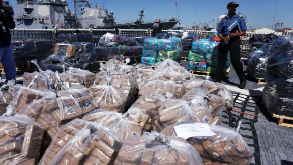SAN DIEGO, CA - APRIL 16:  Coast Guard personel stand aboard the USS Boutwell while officials unload bails of cocaine caught at sea while on deployment on April 16, 2015 at Naval Base San Diego in San Diego, California.  Officials from the United States and Canada seized over 28,000 pounds of cocaine while on patrol in the Eastern Pacific which resulted in a record seizure.(Photo by Sandy Huffaker/Getty Images)