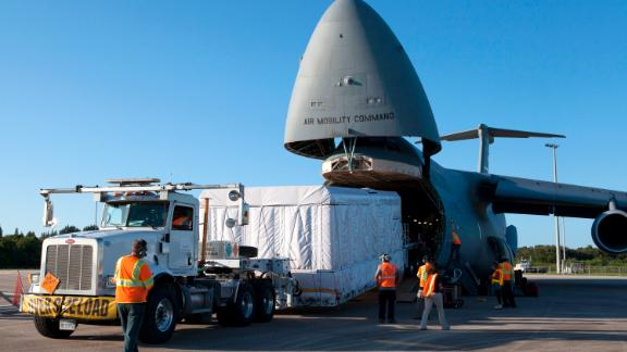 C-5s help NASA by transporting giant satellites to their launch sites for deliver into orbit. This GOES weather satellite is now circling the Earth, helping scientists learn more about the weather.