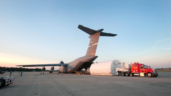 A C-5 also transported a Webb telescope backplane Pathfinder -- or practice model -- and unloaded it at Joint Base Andrews in Maryland.