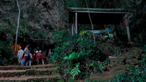 Rescue teams gather at the entrance of a deep cave where a group of boys went missing in Chiang Rai, northern Thailand.