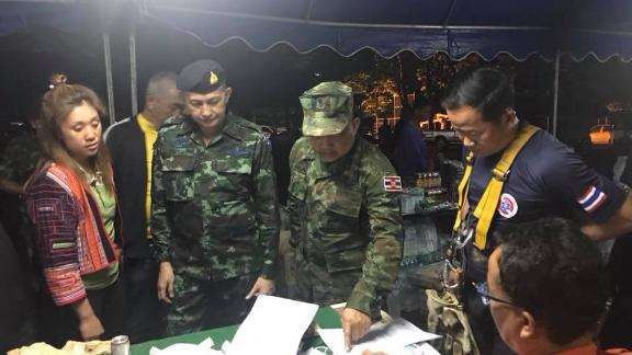 Officials search for a group of 13 trapped in a Thai cave.