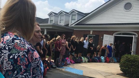 About 100 teachers were named honorary pallbearers at Waddell's funeral.