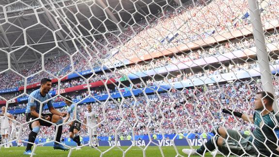 Uruguayan forward Luis Suarez, left, reacts after the second goal deflected past Russian goalkeeper Igor Akinfeev.