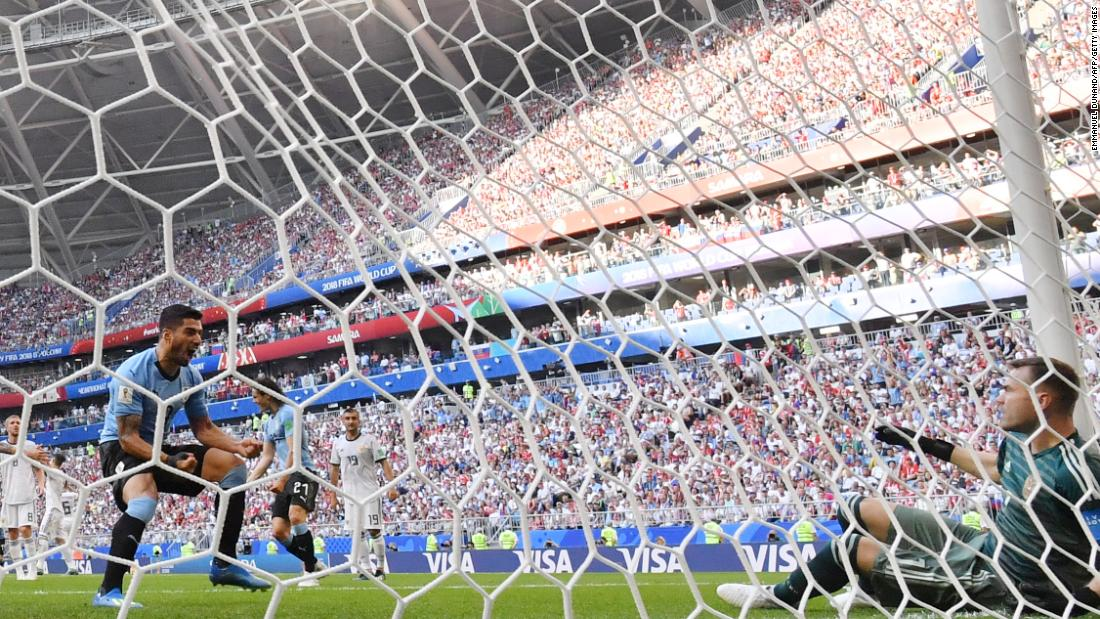 Uruguayan forward Luis Suarez, left, reacts after the second goal deflected past Russian goalkeeper Igor Akinfeev.