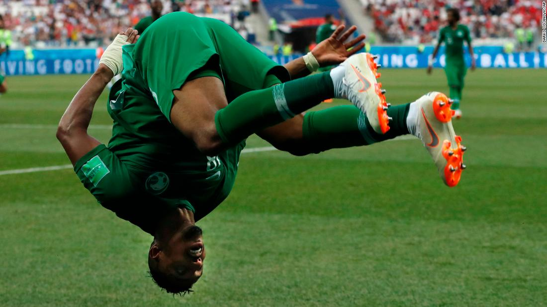 Salem Al-Dawsari celebrates with a flip after scoring the match-winning goal against Egypt.