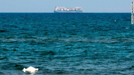 The Alexander Maersk merchant vessel, believed to be carrying over 100 migrants rescued at sea, is seen on the horizon as it waits to be allowed to dock at the Sicilian port of Pozzallo, near Ragusa, southern Italy, Sunday, June 24, 2018. The leaders of Germany, France and about a dozen other European Union nations are converging on Brussels for an afternoon of informal talks on differences over migration ahead of a full EU summit that starts next Thursday. (Santino Galazzo/ANSA via AP)
