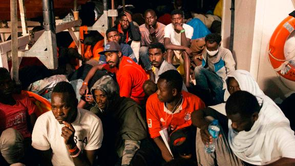 Rescued migrants sit in the search and rescue ship Lifeline earlier this week.
