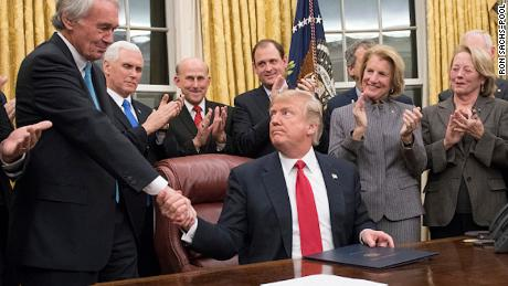 US President Donald Trump shakes hands with US Senator Ed Markey, after signing a bill intended to prevent the flow of opioids into the United States, January 10, 2018.