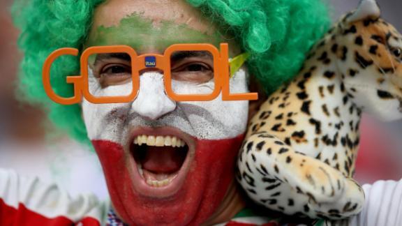 An Iran fan enjoys the pre-match atmosphere.