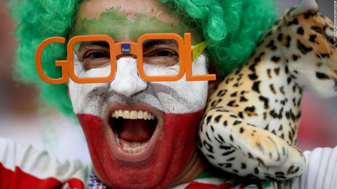 An Iran fan enjoys the pre-match atmosphere.