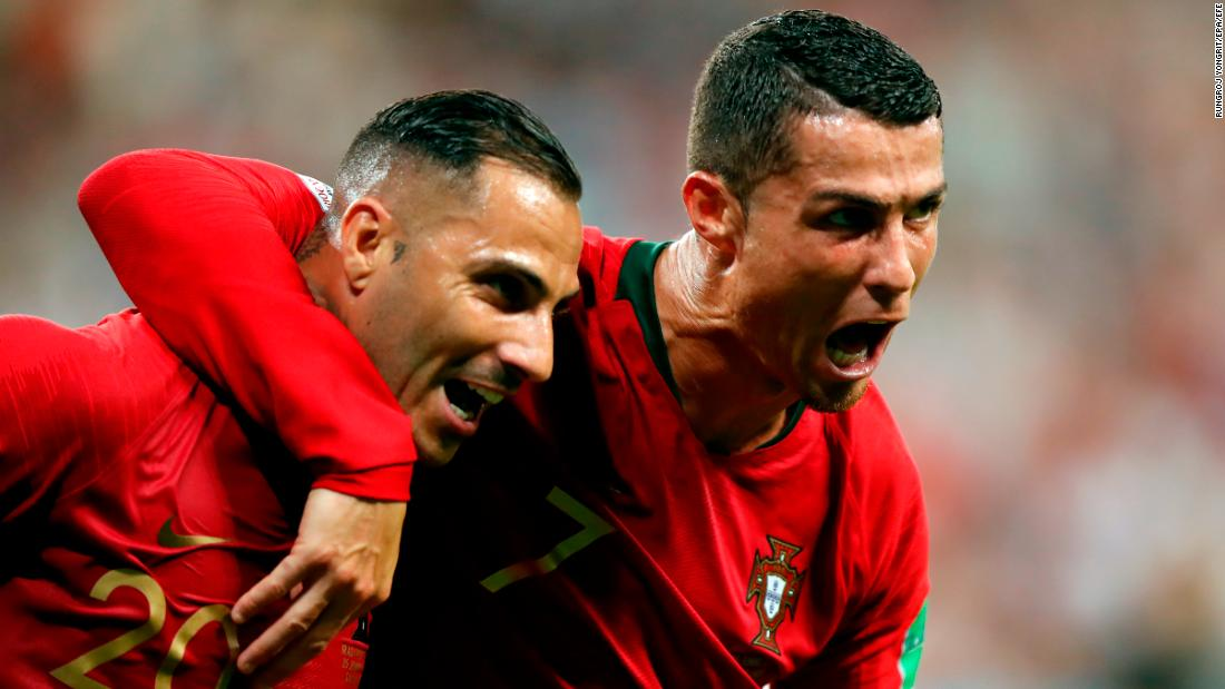Portugal's Ricardo Quaresma, left, is embraced by Cristiano Ronaldo after scoring against Iran on Monday, June 25. Iran scored late to tie the match, but the 1-1 result was enough to see Portugal into the next round.
