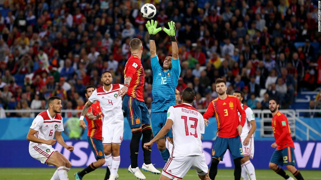 Moroccan goalkeeper Munir catches the ball against Spain.