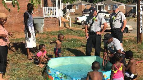 Charlotte firefighters stopped to help fill up this pool on Sunday.