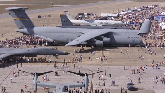 The largest airplane in the US military, the Air Force C-5 Galaxy dwarfs all other aircraft in this 2004 photo from Florida's Eglin Air Force Base. Click through the gallery for examples of the huge military equipment this monster airplane can haul.