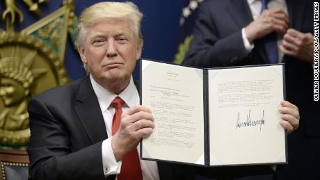 "ARLINGTON, VA - JANUARY 27: U.S. President Donald Trump signs executive orders in the Hall of Heroes at the Department of Defense on January 27, 2017 in Arlington, Virginia. Trump signed two orders calling for the ""great rebuilding"" of the nation's military and the ""extreme vetting"" of visa seekers from terror-plagued countries. (Photo by Olivier Douliery/Pool/Getty Images)"