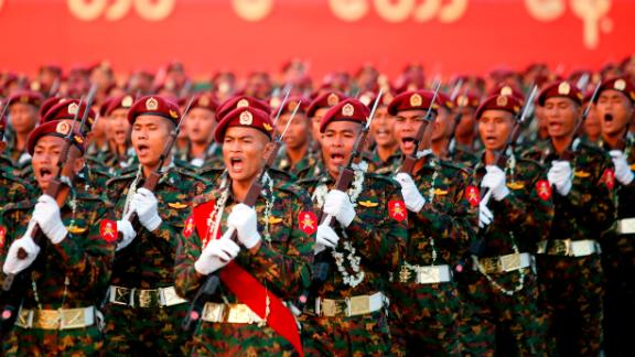 Myanmar soldiers march in formation during a military parade in Naypyidaw on March 27, 2018.