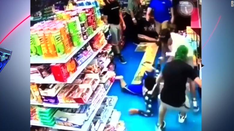 Surveillance video shows the teenager being dragged out of a Bronx bodega by a group of men.