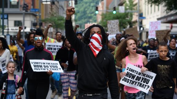 Trey Willis, 32, of Washington, Pennsylvania, marches during a Tuesday protest in downtown Pittsburgh.