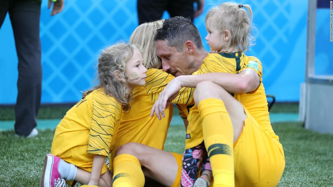 Australian player Mark Milligan is joined by his children after a 2-0 loss to Peru on Tuesday.