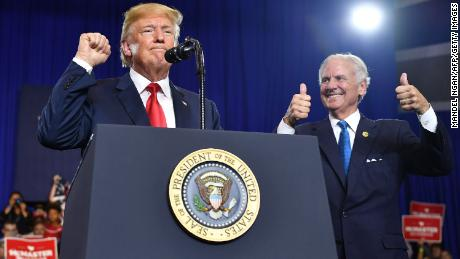 South Carolina Governor Henry McMaster (R) gives two thumbs up as US President Donald Trump speaks during a rally at Airport High School in West Columbia, South Carolina, on June 25, 2018. (Photo by MANDEL NGAN / AFP)        (Photo credit should read MANDEL NGAN/AFP/Getty Images)