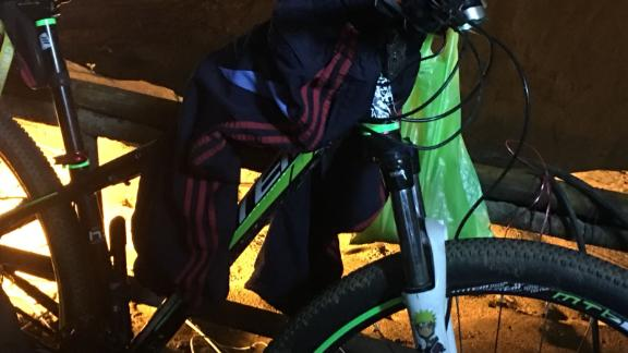A bicycle belonging to one of the missing boys is seen outside the cave complex.