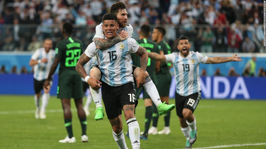 Argentina star Lionel Messi rides on the back of Marcos Rojo after Rojo's winner against Nigeria on Tuesday, June 26.