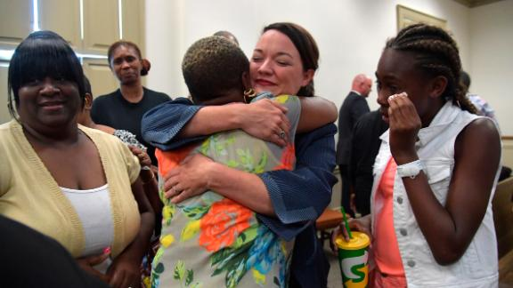 Assistant District Attorney Marie Broder, center, celebrates the verdict with Coggins