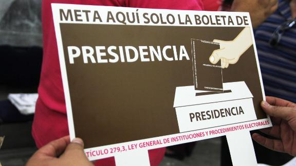 A worker with the National Electoral Institute prepares for Sunday's vote in the state of Chihuahua.