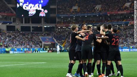 Croatia's forward Ivan Perisic is congratulated by teammates after scoring his team's second goal