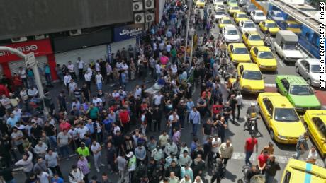 Iranian protesters gather during a demonstration in central Tehran on June 25, 2018.