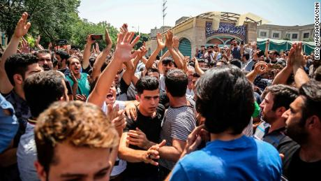 Protesters chant slogans at the main gate of the Grand Bazaar on Monday.