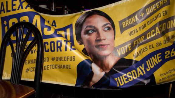 NEW YORK, NY - JUNE 26: A banner for progressive challenger Alexandria Ocasio-Cortez hangs across chairs at her victory party in the Bronx after an upset against incumbent Democratic Representative Joseph Crowly on June 26, 2018 in New York City.  Ocasio-Cortez upset Rep. Joseph Crowley in New York