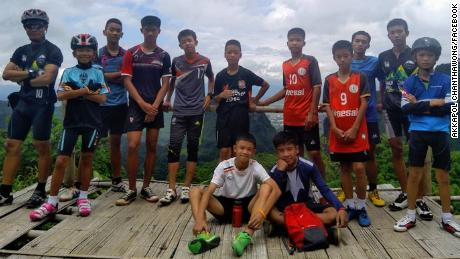The missing boys, with their coach, are seen here in a photo taken from the coach's Facebook page.