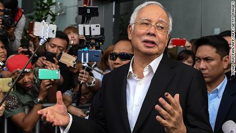 Najib has been banned from leaving the country as police investigate the 1MDB scandal.