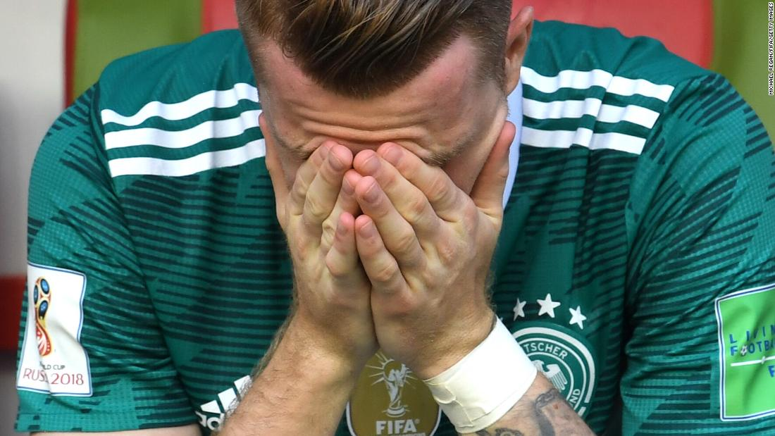 Germany's Marco Reus reacts after his team lost to South Korea and was knocked out of the World Cup on Wednesday, June 27. The defending champions lost 2-0 and finished at the bottom of Group F.