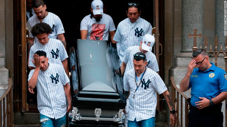 The body of Lesandro Guzman-Feliz, who went by Junior, is taken from the Our Lady of Mount Carmel church after funeral services on June 27, 2018 in New York.