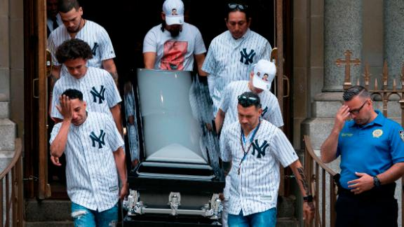 The body of Lesandro Guzman-Feliz is taken from the Our Lady of Mount Carmel church after funeral services last month.