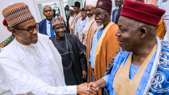 Nigeria's President Muhammadu Buhari visits Plateau State, where police said at least 86 people were killed by armed herdsmen on June 26, 2018.