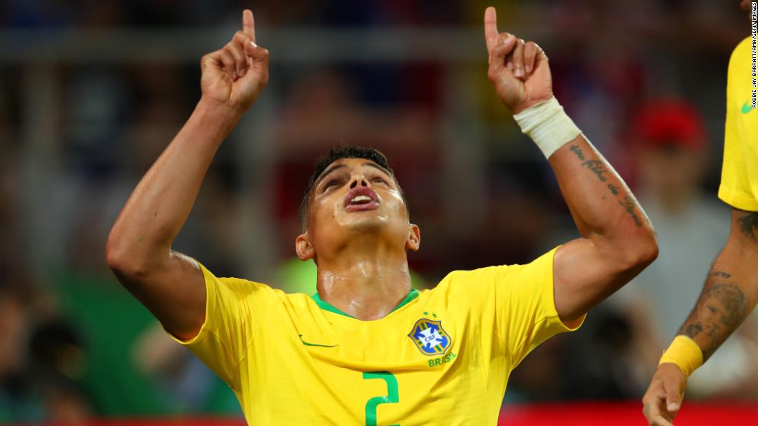 Brazilian defender Thiago Silva celebrates after his powerful header gave Brazil a 2-0 lead over Serbia on Wednesday. Brazil won Group E with two victories and a draw.