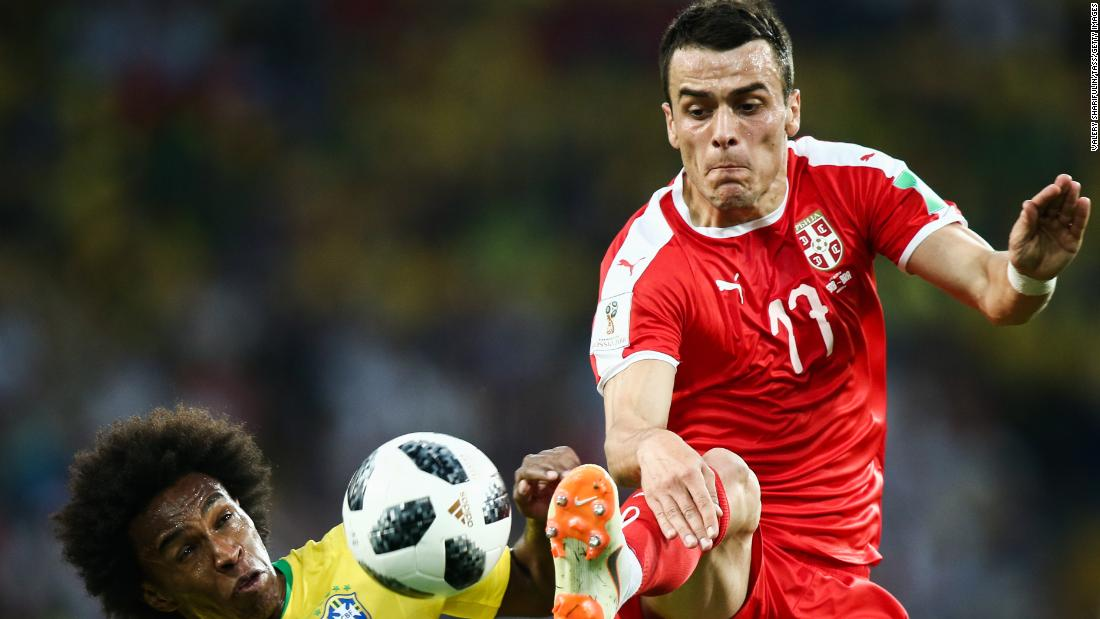 Brazil's Willian and Serbia's Filip Kostic fight for the ball during Wednesday's match.