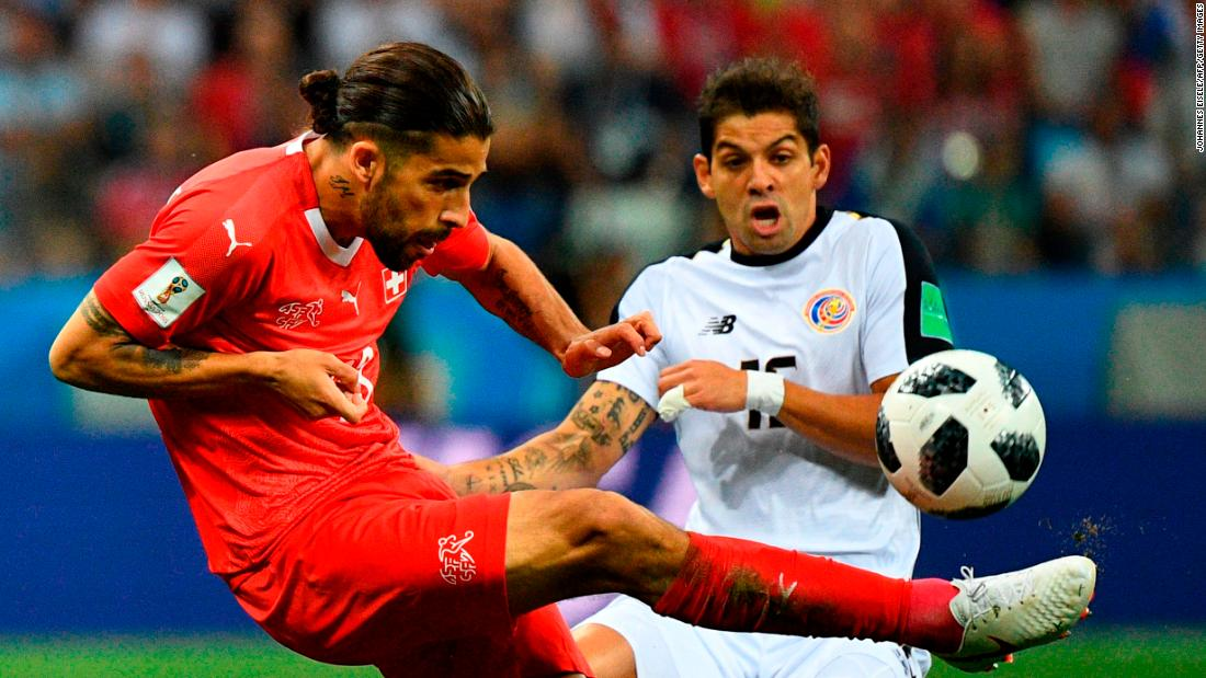 Costa Rican defender Cristian Gamboa vies for the ball with Swiss defender Ricardo Rodriguez.